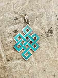 pendente tibetano argento turchese rappresentante il Nodo infinito